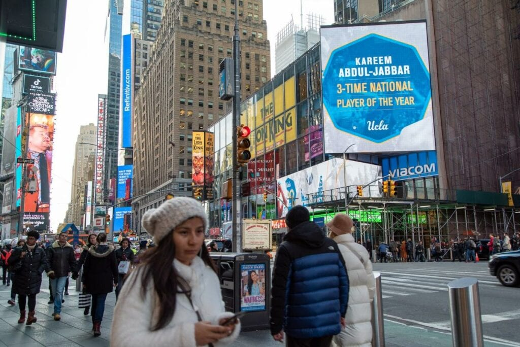 Ucla, under armour celebrate centennial with times square campaign